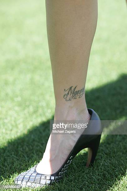 Juliana Ramirez shows off her tattoo for her husband Manny Ramirez following a workout during spring training at the Phoenix Municipal Stadium on...