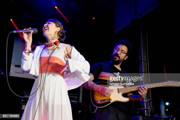 Juliana Ronderos and Nicolas Losada of Salt Cathedral perform onstage at Pandora during SXSW at The Gatsby on March 14 2018 in Austin Texas