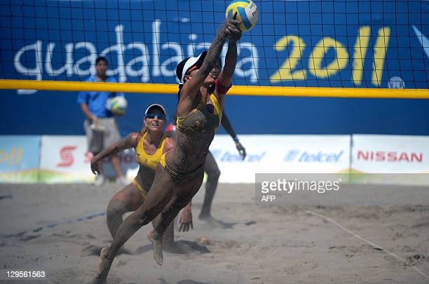 Juliana Silva of Brazil dives for the ball during a women's beach volleyball match against Cuba at the XVI Pan American Games in Puerto Vallarta...