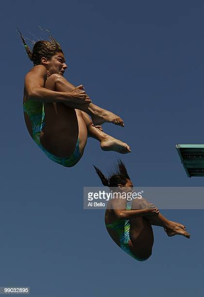 Juliana Veloso and Tammy Takagi of Brazil dive during the Women's Synchronized 3 Meter Final at the Fort Lauderdale Aquatic Center during Day 4 of...