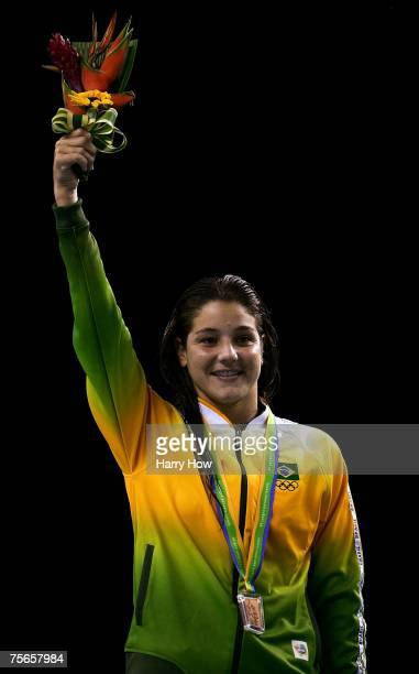 Juliana Veloso of Brazil smiles with her bronze medal after the Women's 10m Platform competition in the 2007 XV Pan American Games at Aquatic Park on...