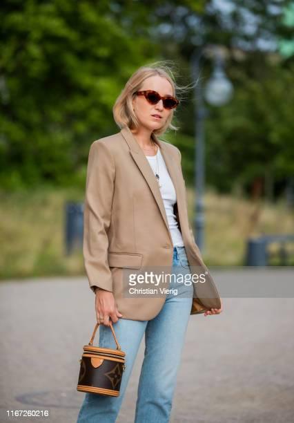 Juliane Diesner is seen wearing Louis Vuitton bag, denim jeans, beige blazer outside Samsøe & Samsøe during Copenhagen Fashion Week Spring/Summer...