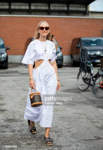 Juliane Diesner is seen wearing white ripped dress, Louis Vuitton bag outside By Malene Birger during Copenhagen Fashion Week Spring/Summer 2020 on...