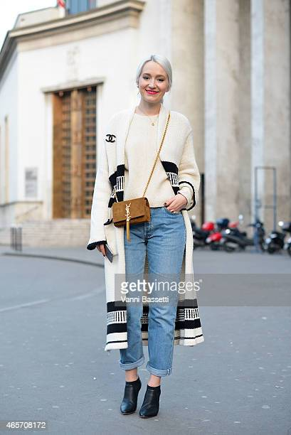 Juliane Diesner poses wearing a Zara coat YSL bag Levi's pants and Jimmy Choo shoes on Day 7 of Paris Fashion Week Womenswear FW15 on March 9 2015 in...