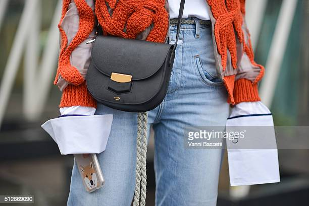 Juliane Diesner poses wearing an Anna Quan shirt and Celine bag before the Jil Sander show during the Milan Fashion Week Fall/Winter 2016/17 on...
