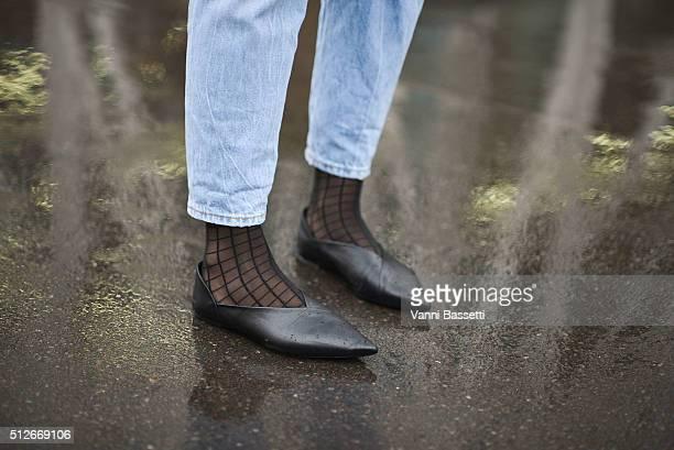 Juliane Diesner poses wearing Zara shoes before the Jil Sander show during the Milan Fashion Week Fall/Winter 2016/17 on February 27 2016 in Milan...