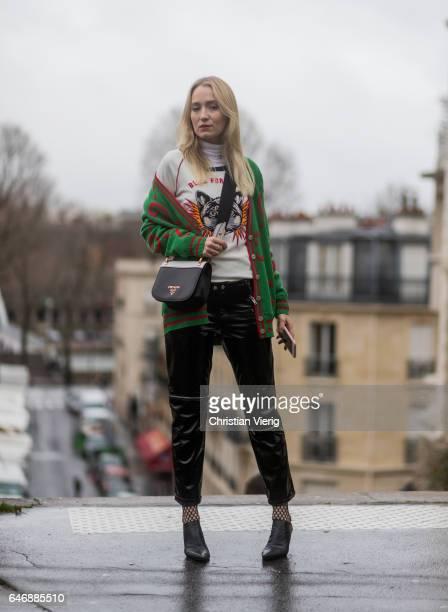Juliane Diesner wearing a Gucci cardigan Prada bag outside Rochas on March 1 2017 in Paris France