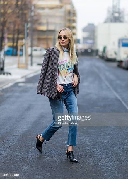 Juliane Diesner wearing a top Chanel white tshirt HM jeans blazer and shoes Acne Studios Chanel bag during the MercedesBenz Fashion Week Berlin A/W...