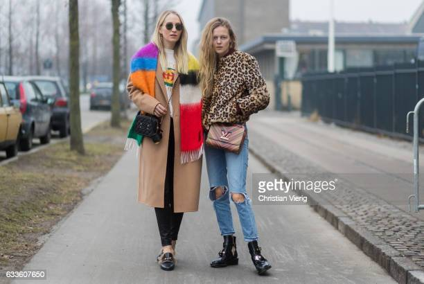 Juliane Diesner wearing a white Gucci shirt black Gucci bag beige coat and Marie von Behrens wearing a leoprint jacket Louis Vuitton bag outside By...