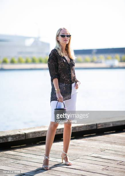 Juliane Diesner wearing animal print white skinny shorts is seen outside Munthe during the Copenhagen Fashion Week Spring/Summer 2019 on August 9...