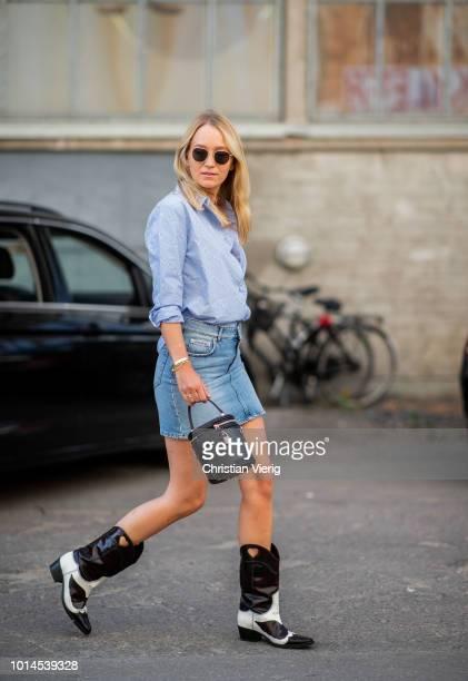 Juliane Diesner wearing blue button shirt denim mini skirt black whit cowboy boots seen outside Ganni during the Copenhagen Fashion Week...