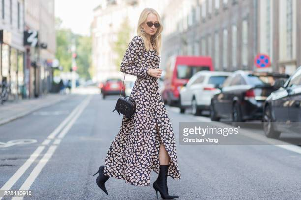 Juliane Diesner wearing Ganni dress with floral print Chanel bag Balenciaga boots on August 09 2017 in Copenhagen Denmark