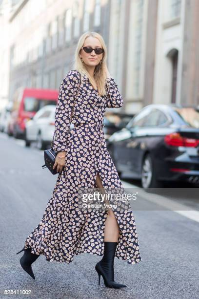 Juliane Diesner wearing Ganni dress with floral print Chanel bag Balenciaga boots on August 09 2017 in Copenhagen Denmark