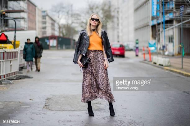 Juliane Diesner wearing Ganni leopard print skirt black leather jacket Ganni Chanel bag Balenciaga boots during the Copenhagen Fashion Week...