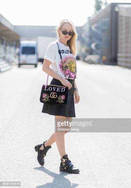 Juliane Diesner wearing Gucci bag with Loved print white printed tshirt mini skirt Balenciaga boots outside By Malene Birger on August 09 2017 in...