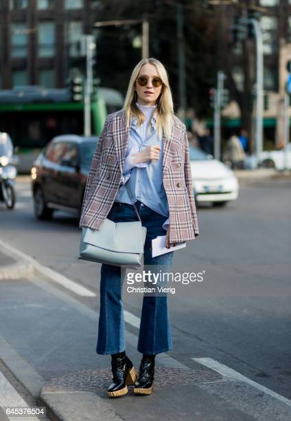 Juliane Diesner wearing Isabel Marant blazer Dior shoes Alexander Mc Queen denim jeans Jil Sander bag and blouse outside Jil Sander during Milan...