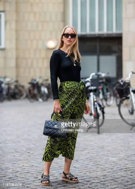 Juliane Diesner wearing skirt with jungle print outside Saks Potts during Copenhagen Fashion Week Spring/Summer 2020 on August 08 2019 in Copenhagen...