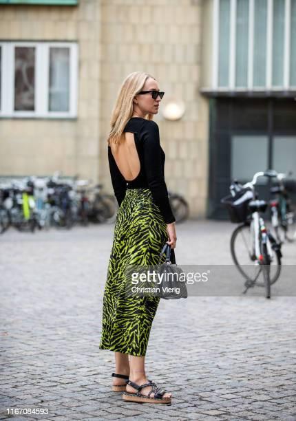 Juliane Diesner wearing skirt with jungle print outside Saks Potts during Copenhagen Fashion Week Spring/Summer 2020 on August 08, 2019 in...