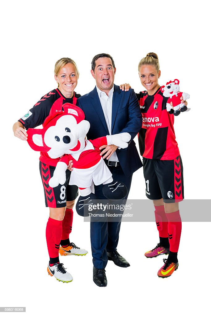 Juliane Maier (L) and Selina Wagner (R) of SC Freiburg pose with Michael Sehringer (C) of Allianz during the Allianz Women's Bundesliga Club Tour on August 31, 2016 in Freiburg im Breisgau, Germany.