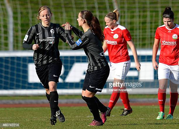 Juliane Maier of Freiburg celebrates her team's second goal with team mate Sara Daebritz during the Women's DFB Cup Quarter Final match between SC...
