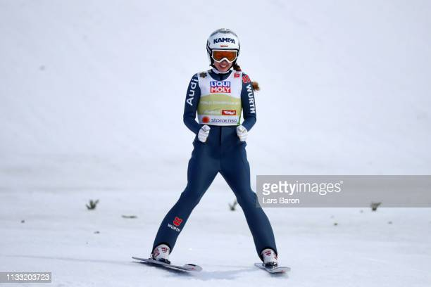 Juliane Seyfarth of Germany celebrates after her jump in the Mixed Team Ski Jumping HS109 competition during the FIS Nordic World Ski Championships...