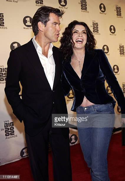 Julianna Margulies and Pierce Brosnan during VH1 Big in 2002 Awards Arrivals at The Grand Olympic Auditorium in Los Angeles California United States