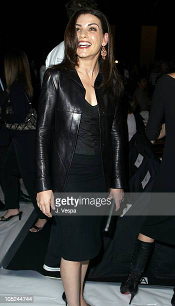 Julianna Margulies during MercedesBenz Fashion Week Spring 2004 Narciso Rodriguez Front Row at Gertrude Tent Bryant Park in New York City New York...