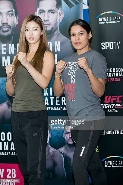 Julianna Pena and Octagon Girl Yu SeungOk aka Seung Ok Yu pose for media before UFC Fight Night Female MMA Class at CrossFit Sentinel IFC on November...