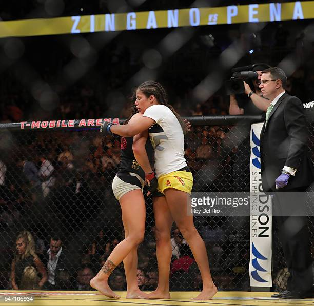 Julianna Pena hugs Cat Zingano during the UFC 200 event at TMobile Arena on July 9 2016 in Las Vegas Nevada