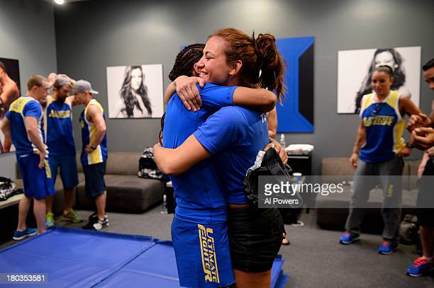 Julianna Pena is embraced by Coach Miesha Tate after defeating Shayna Baszler by submission in their preliminary fight during filming of season...