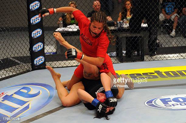 Julianna Pena punches Gina Mazany in their elimination fight during filming of season eighteen of The Ultimate Fighter on May 29 2013 in Las Vegas...