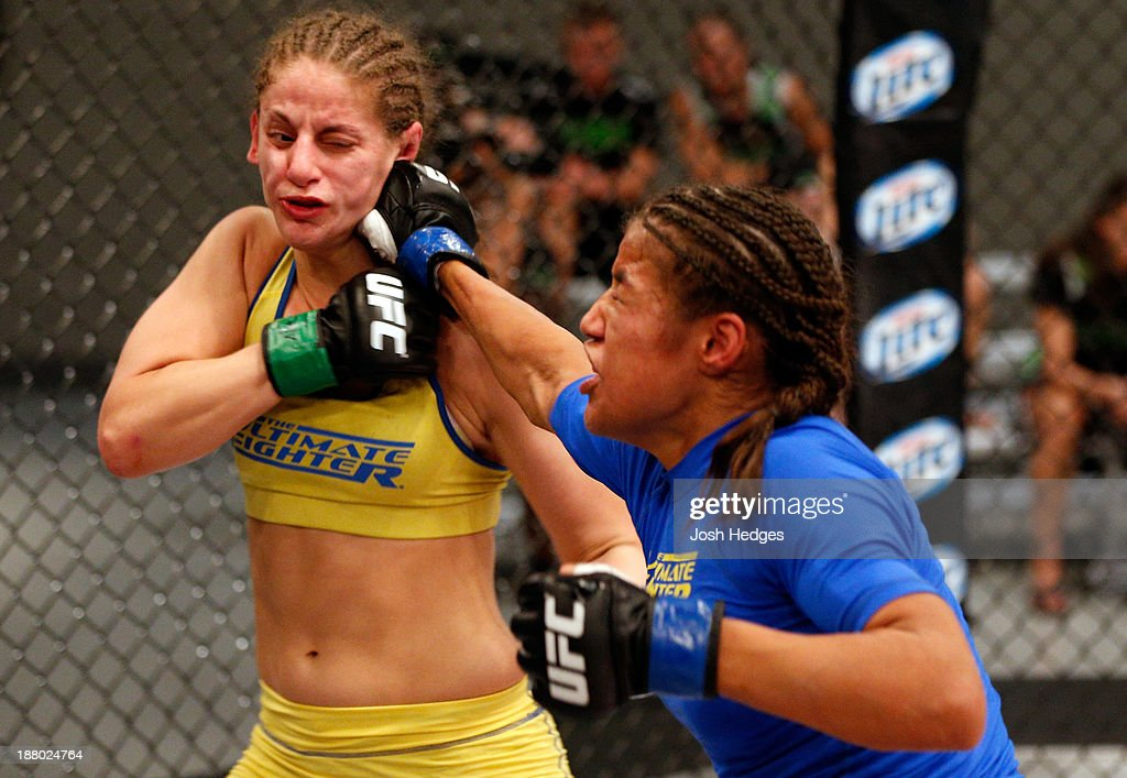 Julianna Pena punches Sarah Moras in their semifinal fight during filming of season eighteen of The Ultimate Fighter on July 2, 2013 in Las Vegas, Nevada.