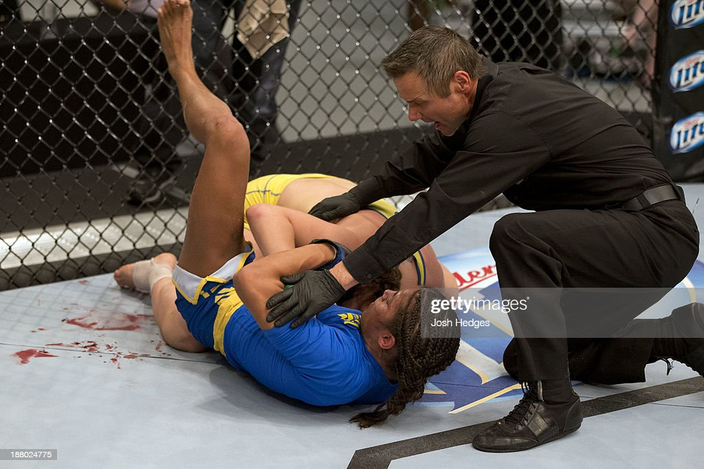 Julianna Pena submits Sarah Moras in their semifinal fight during filming of season eighteen of The Ultimate Fighter on July 2, 2013 in Las Vegas, Nevada.