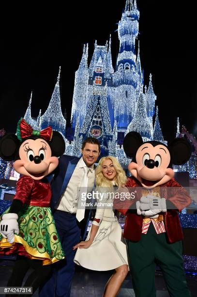 CELEBRATION Julianne Hough and Nick Lachey pose with Mickey Mouse and Minnie Mouse at Magic Kingdom Park in Lake Buena Vista Fla Sunday Nov 5 while...