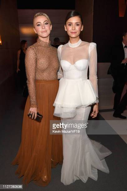 Julianne Hough andNina Dobrev attend the 2019 Vanity Fair Oscar Party hosted by Radhika Jones at Wallis Annenberg Center for the Performing Arts on...