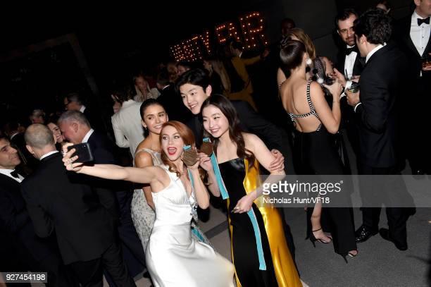 Julianne Hough Nina Dobrev Maia Shibutani and Alex Shibutani attend the 2018 Vanity Fair Oscar Party hosted by Radhika Jones at Wallis Annenberg...