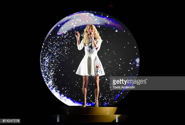 CELEBRATION Julianne Hough sings from a snow globe at Magic Kingdom Park in Lake Buena Vista Fla during a taping for 'The Wonderful World of Disney...