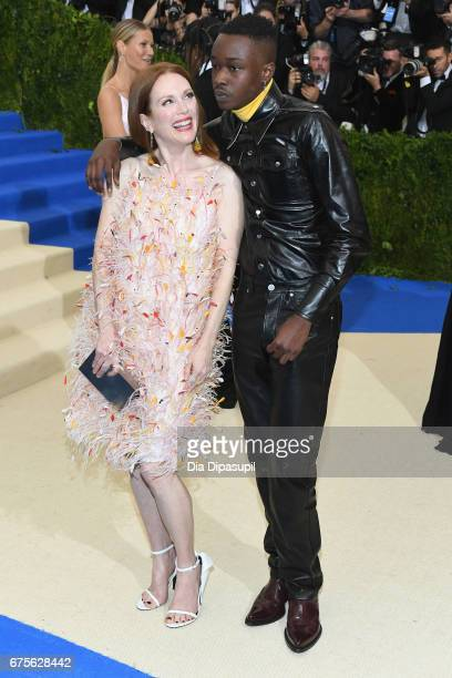 Julianne Moore and Ashton Sanders attend the Rei Kawakubo/Comme des Garcons Art Of The InBetween Costume Institute Gala at Metropolitan Museum of Art...