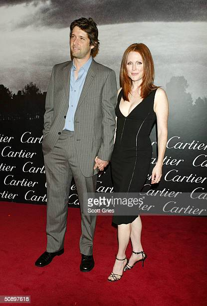 Julianne Moore and Bart Freundlich arrive at Santos Night the 100 Year Anniversary of the Cartier Santos Watch at The Armory May 25 2004 in New York...