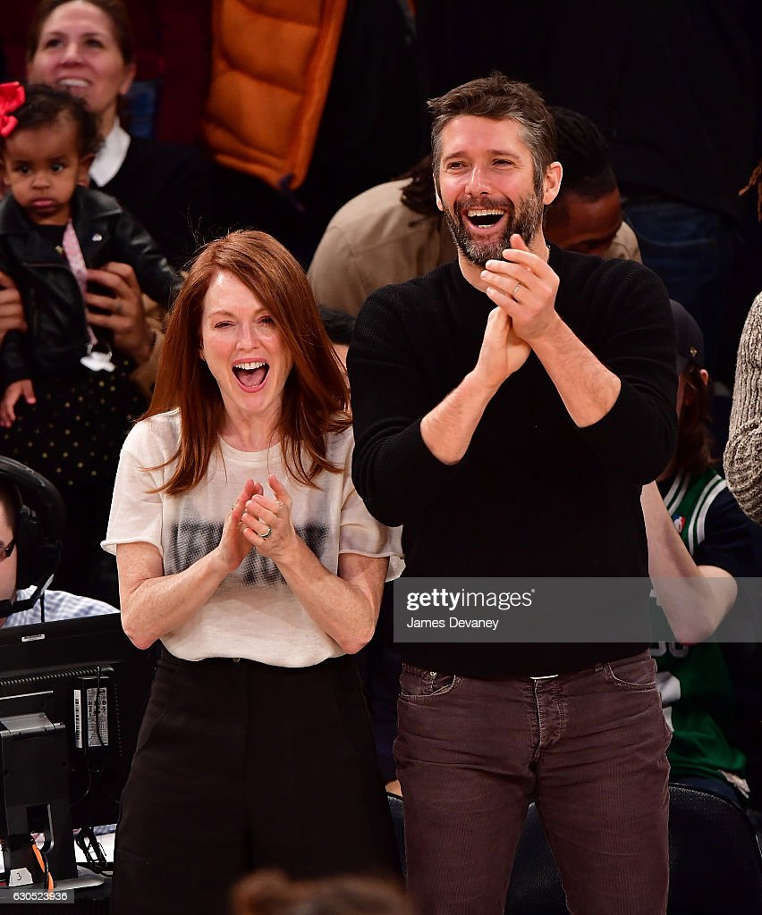 Julianne Moore and Bart Freundlich attend Boston Celtics Vs. New York Knicks game at Madison Square Garden on December 25, 2016 in New York City.