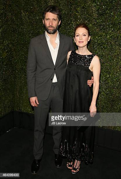 Julianne Moore and Bart Freundlich attend the Chanel And Charles Finch PreOscar Dinner at Madeo Restaurant on February 21 2015 in West Hollywood...