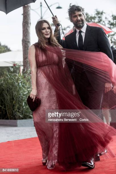 Julianne Moore and Bart Freundlich attend the The Franca Sozzani Award during the 74th Venice Film Festival at Sala Giardino on September 1 2017 in...