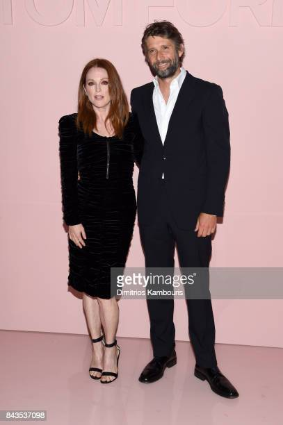 Julianne Moore and Bart Freundlich attend the Tom Ford Spring/Summer 2018 Runway Show at Park Avenue Armory on September 6 2017 in New York City