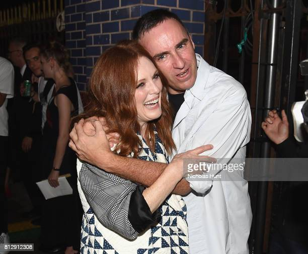Julianne Moore and designer Raf Simons attend the Raf Simons Front Row/Backstage at NYFW Men's July 2017 on July 11 2017 in New York City
