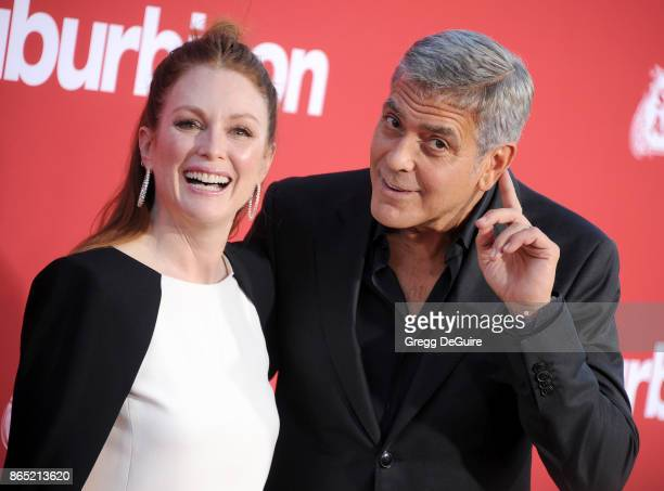 Julianne Moore and George Clooney arrive at the premiere of Paramount Pictures' Suburbicon at Regency Village Theatre on October 22 2017 in Westwood...