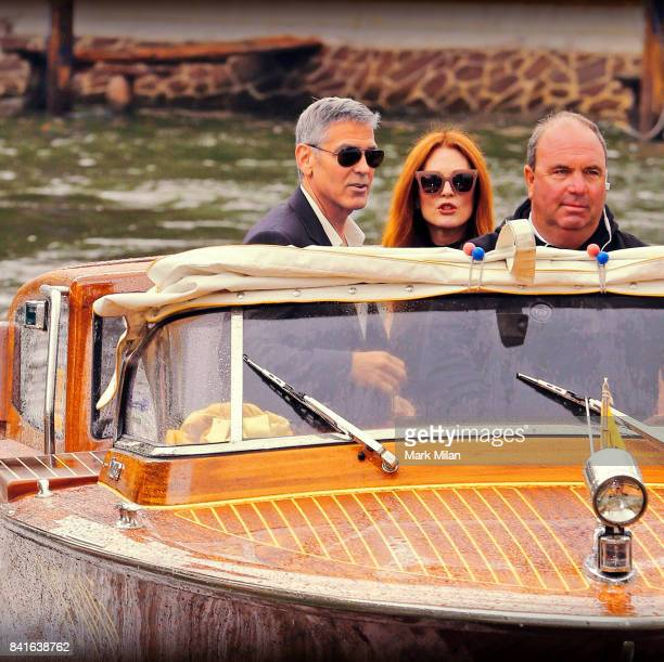 Julianne Moore and George Clooney arrive on their water taxi during the 74th Venice Film Festival on September 1 2017 in Venice Italy