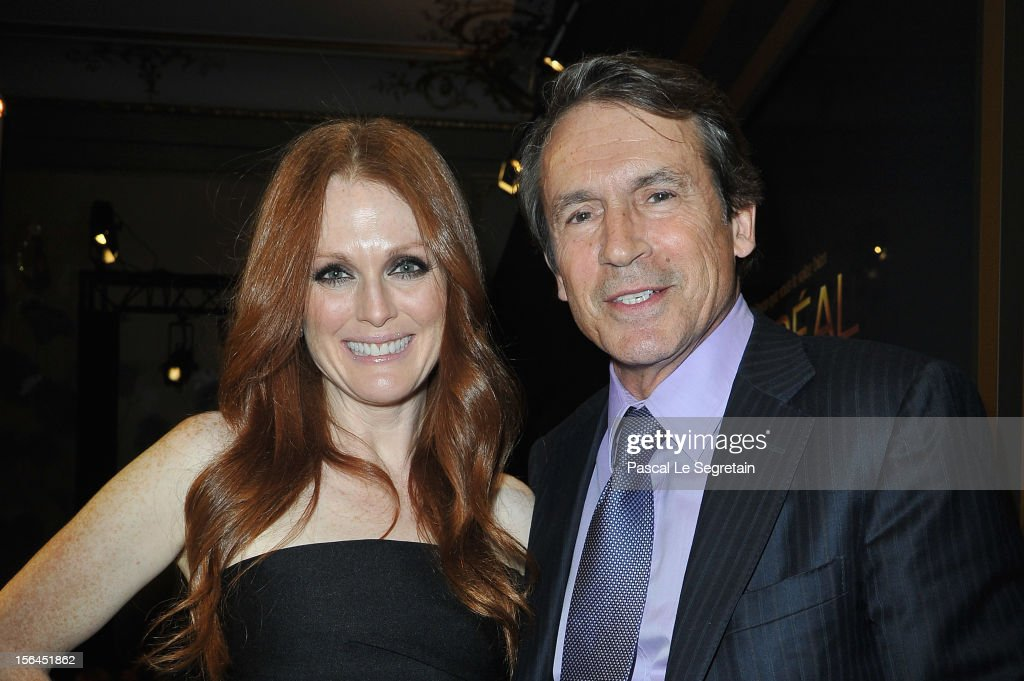 Julianne Moore and Jean Jacques Lebel pose during the l'Oreal new egerie presentation at Hotel D'Evreux on November 15, 2012 in Paris, France.