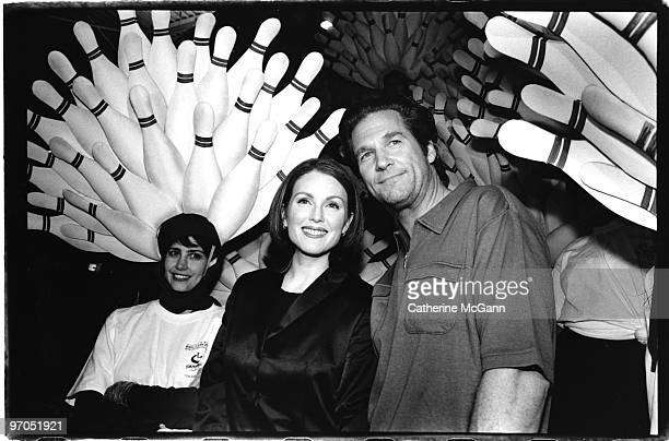 Julianne Moore and Jeff Bridges pose for a photo at the party for the premiere of the film 'The Big Lebowski' on February 23 1998 in New York City...