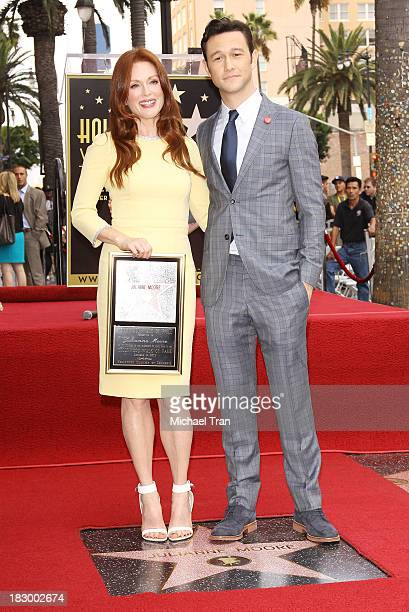 Julianne Moore and Joseph GordonLevitt attend the ceremony honoring Julianne Moore with a Star on The Hollywood Walk of Fame held on October 3 2013...