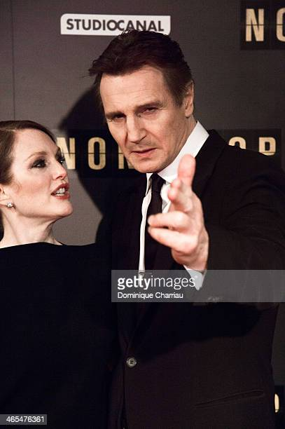 Julianne Moore and Liam Neeson attend the 'Non Stop' Paris Premiere at Cinema Gaumont Opera on January 27 2014 in Paris France